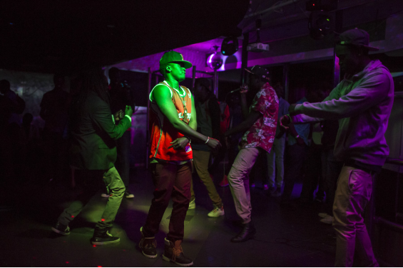 A crownd of young South Sudanese Australians dance on the dancefloor of Will Da Kid's EP mixtape launch in Canberra.
