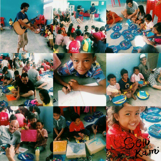 Some of the underprivileged children with Senikami volunteers during the creative arts workshops