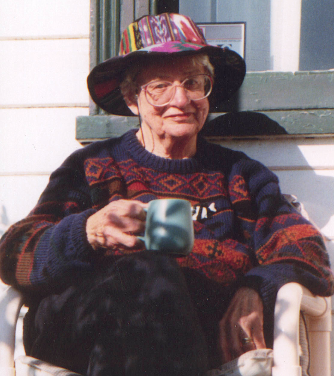 Judith Wright sitting with a cuppa