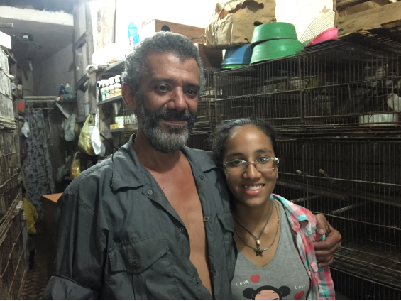 Shop owner with his daughter